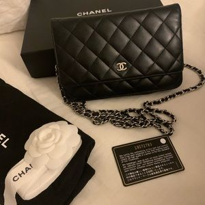Authentic Chanel WOC Lambskin Black